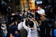 i-Cable TV news journalist talkes to the media after being laid off in Hong Kong