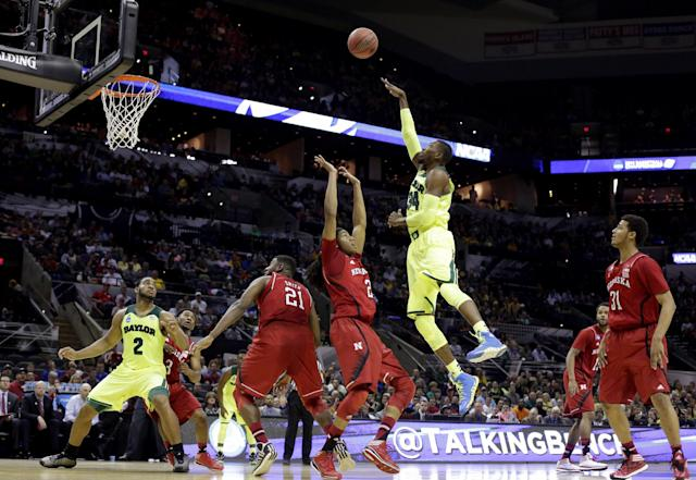 Baylor's Cory Jefferson (34) shoots over Nebraska's David Rivers (2) during the first half of a second-round game in the NCAA college basketball tournament Friday, March 21, 2014, in San Antonio. (AP Photo/Eric Gay)