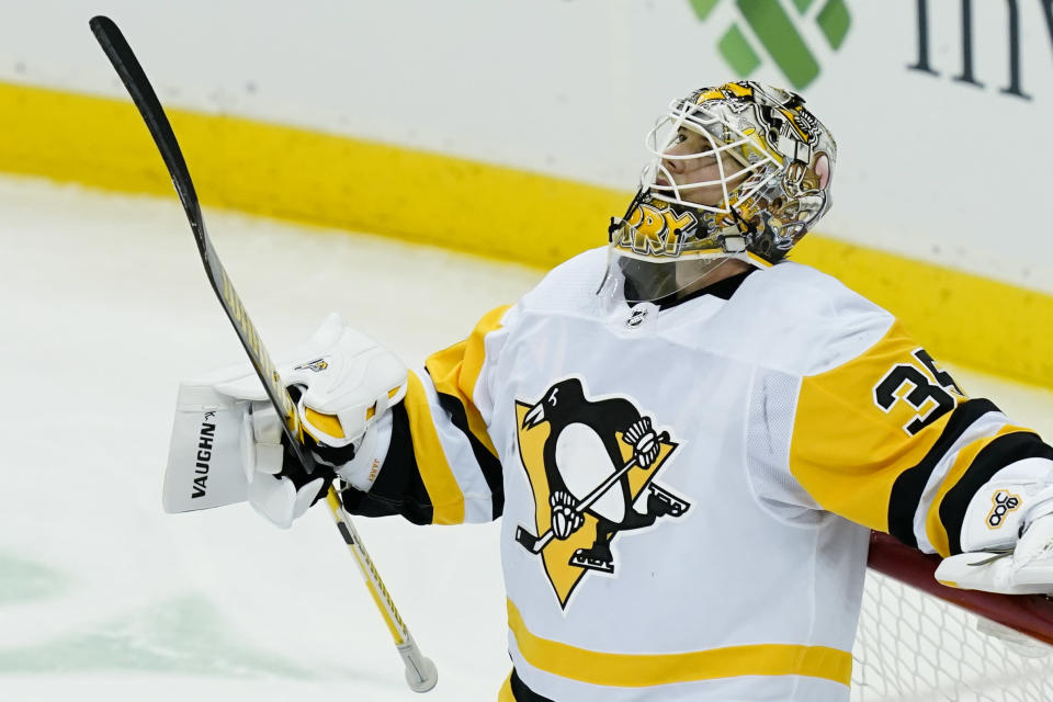 Pittsburgh Penguins goaltender Tristan Jarry reacts after giving up a goal to New Jersey Devils defenseman Damon Severson during the second period of an NHL hockey game Thursday, March 18, 2021, in Newark, N.J. (AP Photo/John Minchillo)