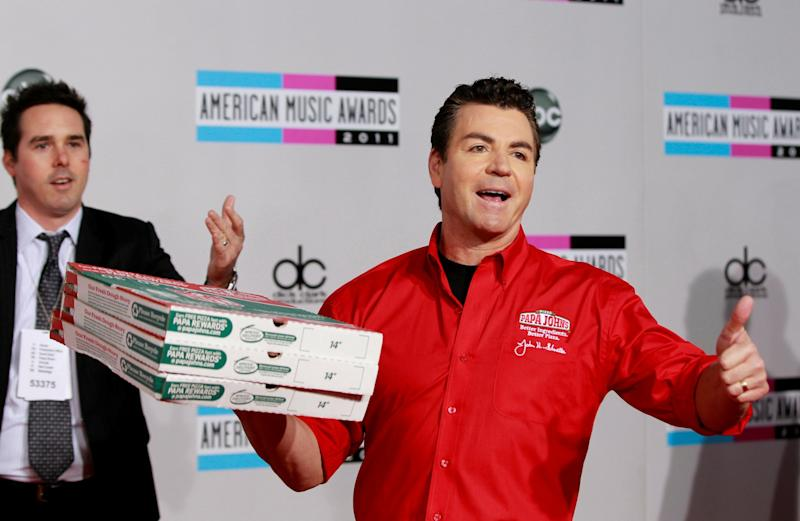 Quit: John Schnatter (R), founder of Papa John's Pizza, has stepped down as chairman after using a racial slur: REUTERS