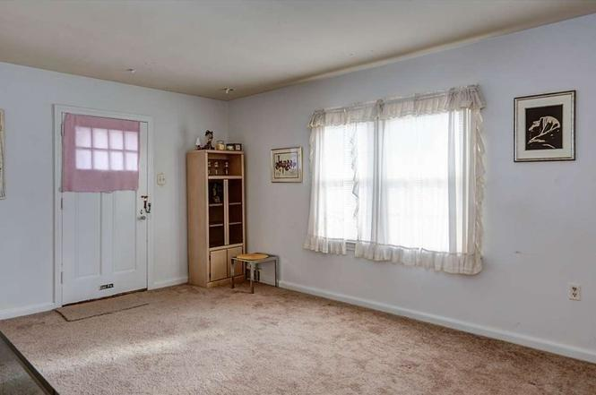 """<div class=""""caption""""> Before: We did not mind telling that carpet goodbye. </div>"""