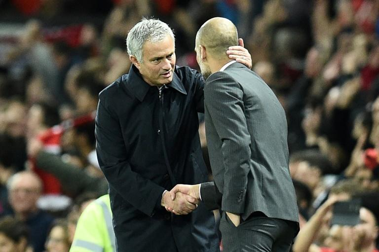 Manchester United's manager Jose Mourinho (L) shakes hands with Manchester City's counterpart Pep Guardiola after their English Football League Cup match, in October 2016