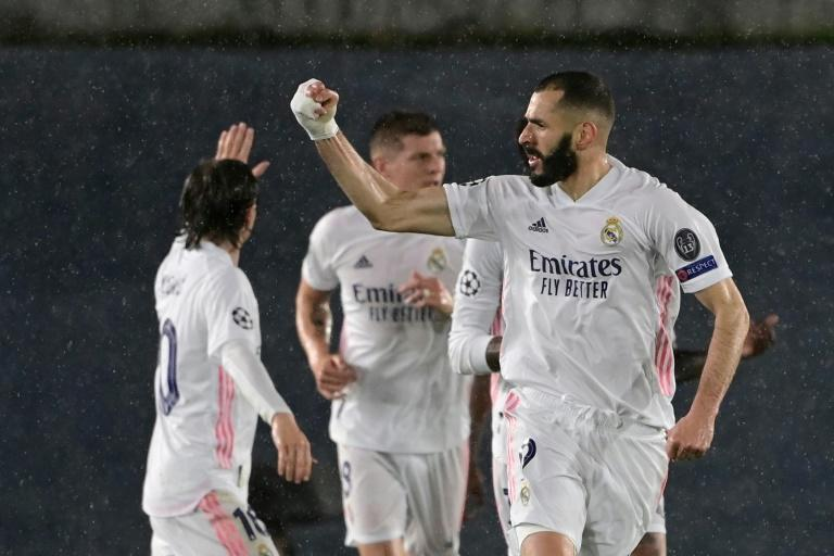 Karim Benzema (right) equalled Raul's tally of 71 Champions League goals