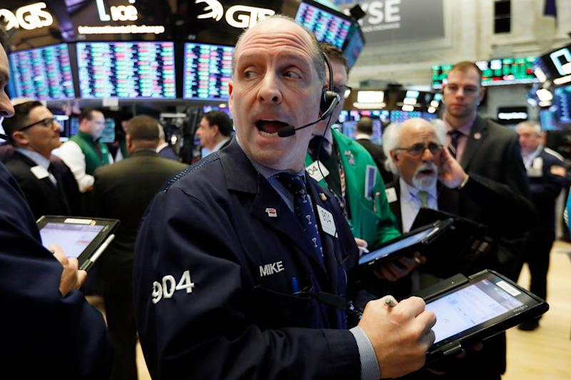 Trader Michael Unkonis, center, works on the floor of the New York Stock Exchange, Tuesday, Jan. 29, 2019. Stocks are opening slightly higher on Wall Street as several big U.S. companies reported solid results for the latest quarter. (AP Photo/Richard Drew)