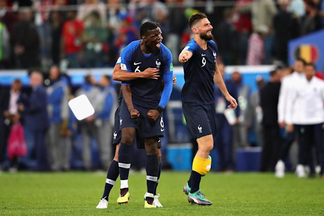 <p>Paul Pogba of France celebrates with teammates Olivier Giroud and Raphael Varane after the 2018 FIFA World Cup Russia Semi Final match between Belgium and France at Saint Petersburg Stadium on July 10, 2018 in Saint Petersburg, Russia. (Photo by Chris Brunskill/Fantasista/Getty Images) </p>