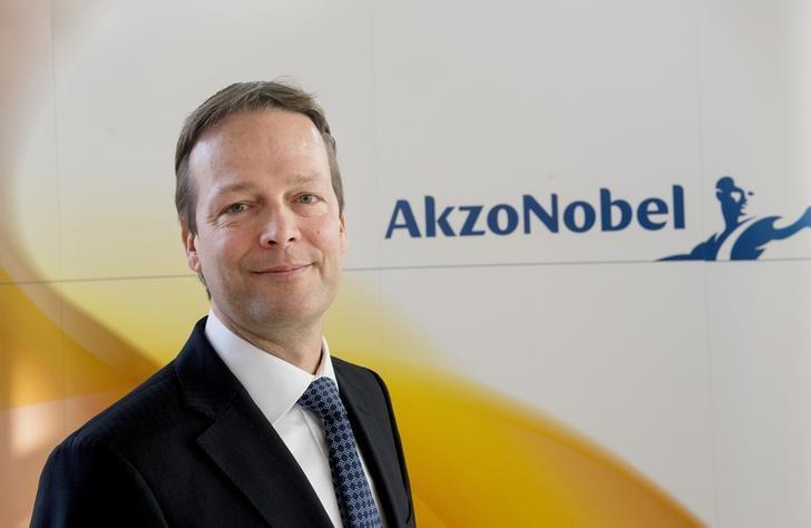 Buchner, CEO of AkzoNobel, poses during a photocall at the presentation of the 2013 full-year results in Amsterdam.