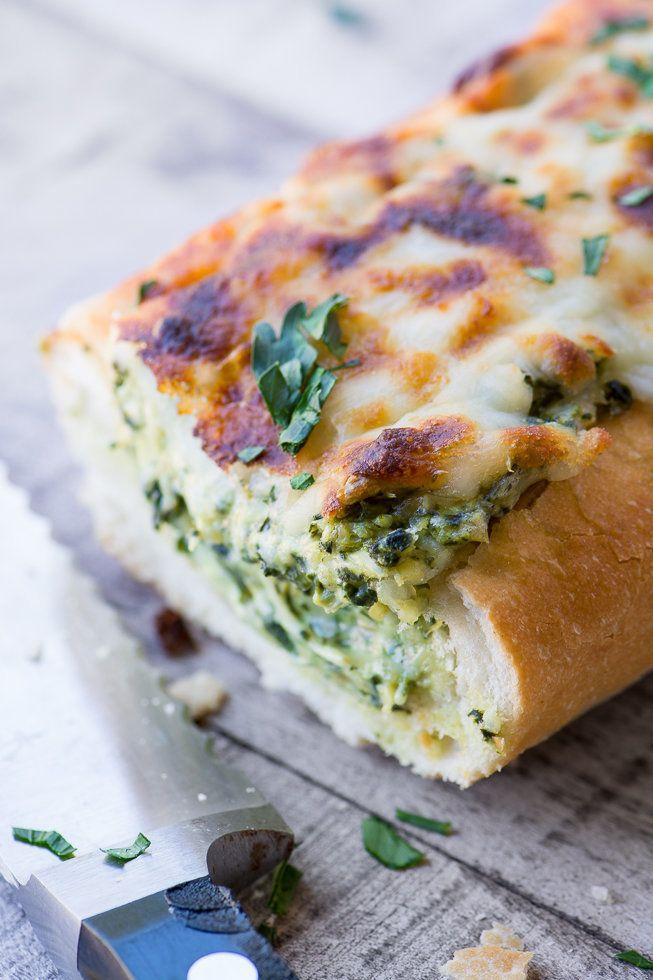 """<strong>Get the <a href=""""https://theviewfromgreatisland.com/cheesy-spinach-artichoke-bread-recipe/"""" target=""""_blank"""">Cheesy Spinach Artichoke Bread recipe</a>fromThe View from Great Island</strong>"""