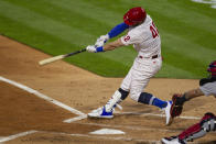 Philadelphia Phillies Bryce Harper swings on an RBI double during the second inning of the team's baseball game against the St. Louis on Cardinals, Friday, April 16, 2021, in Philadelphia. (AP Photo/Laurence Kesterson)