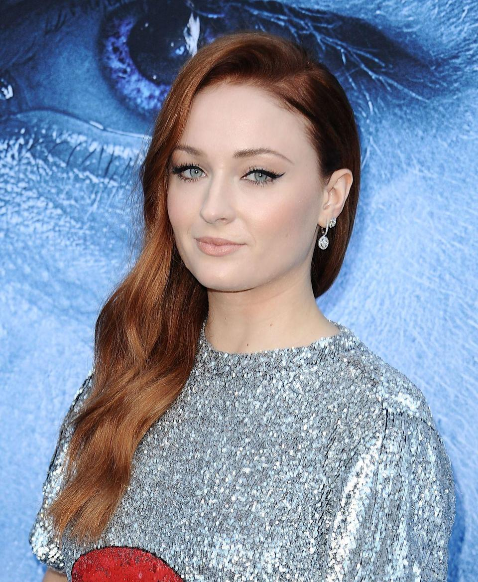 <p>It might not be her natural hair colour but Sophie Turner's faux copper lengths are the rich tone of our hair dye dreams.</p>