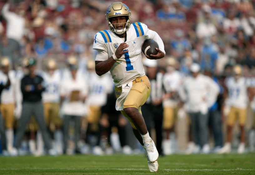UCLA quarterback Dorian Thompson-Robinson runs for a two-yard, second-quarter touchdown against Stanford on Sept. 25, 2021.