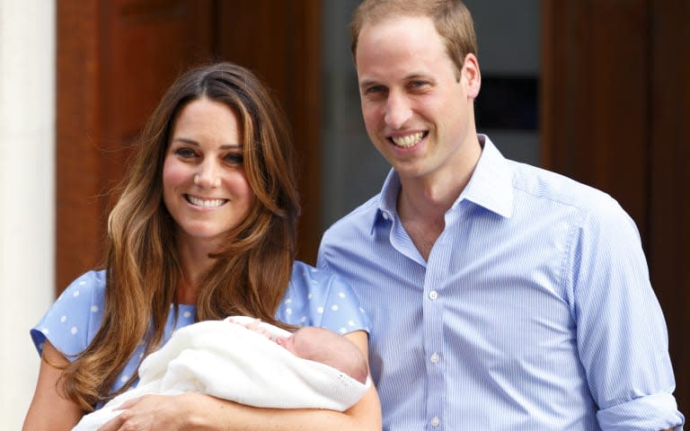 Kate Middleton and Prince William holding royal baby