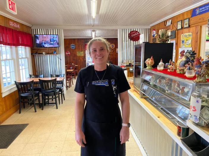 Linda Mashburn poses at the Tiny Town Restaurant in Homer