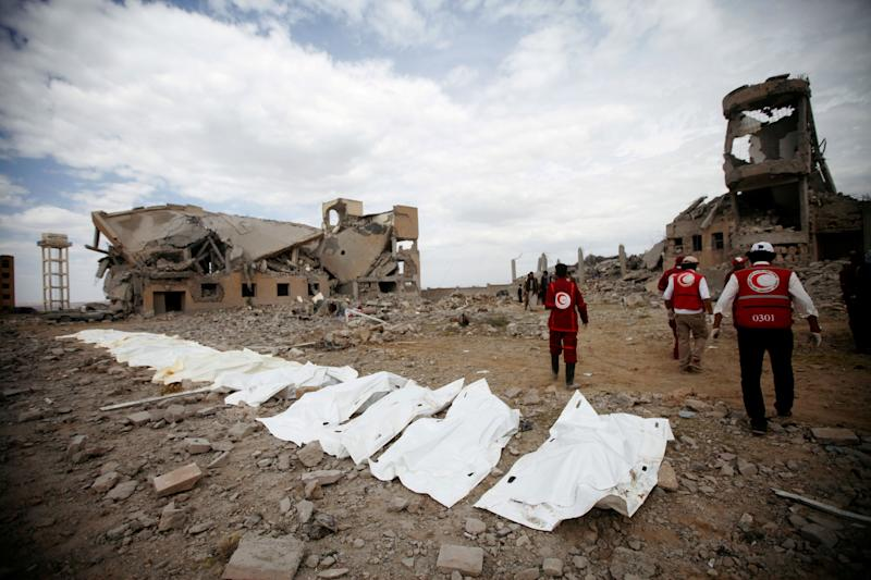 Red Crescent medics walk next to bags containing the bodies of victims of Saudi-linked airstrikes on a Houthi detention center in Yemen on Sept. 1, 2019. The Saudis military campaign in Yemen has relied on U.S. weaponry to commit scores of alleged war crimes. (Photo: Mohamed Al-Sayaghi / Reuters)