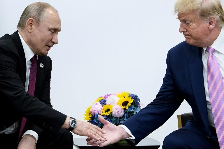 Russia's President Vladimir Putin is likely to ask US President Donald Trump for lifting sanctions on Moscow during their phone call expected Monday