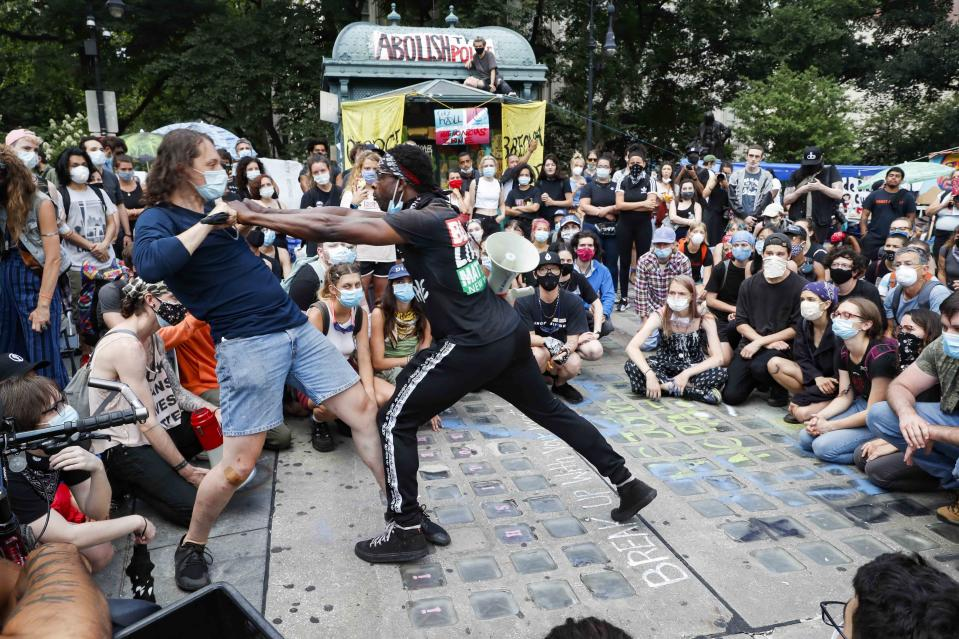 Protesters learn defensive tactics during a demonstration at an encampment outside City Hall, Tuesday, June 30, 2020, in New York. New York City lawmakers are holding a high-stakes debate on the city budget as activists demand a $1 billion shift from policing to social services and the city grapples with multibillion-dollar losses because of the coronavirus pandemic. (AP Photo/John Minchillo)