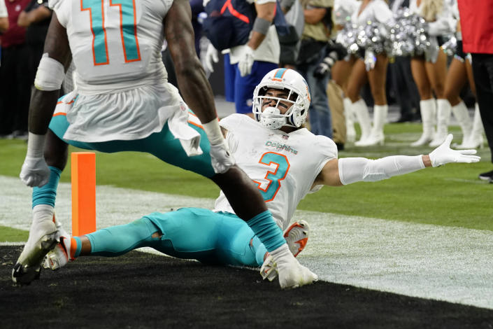 Miami Dolphins wide receiver Will Fuller (3) reacts after making a catch for a two-point conversion against the Las Vegas Raiders during the second half of an NFL football game, Sunday, Sept. 26, 2021, in Las Vegas. (AP Photo/Rick Scuteri)