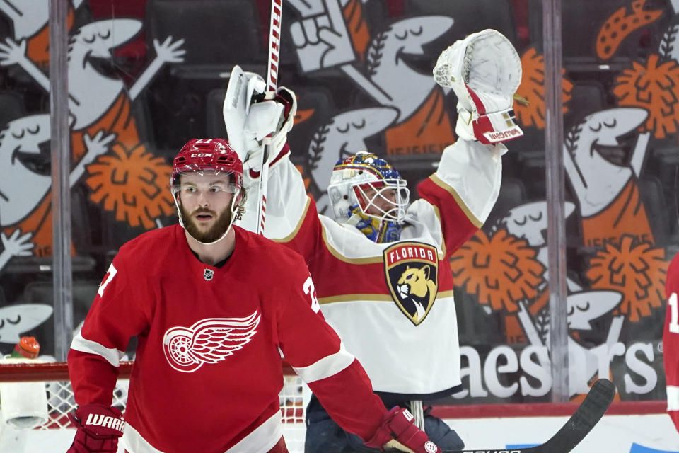 Florida Panthers goaltender Chris Driedger (60) celebrates beating the Detroit Red Wings 3-2 after an NHL hockey game Sunday, Jan. 31, 2021, in Detroit. (AP Photo/Paul Sancya)