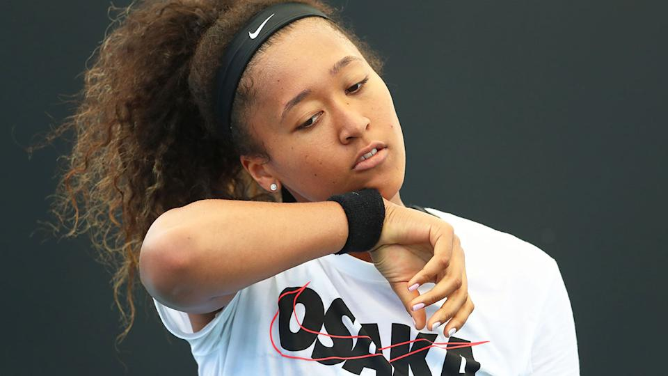 Naomi Osaka is seen here looking sad during a practice session.