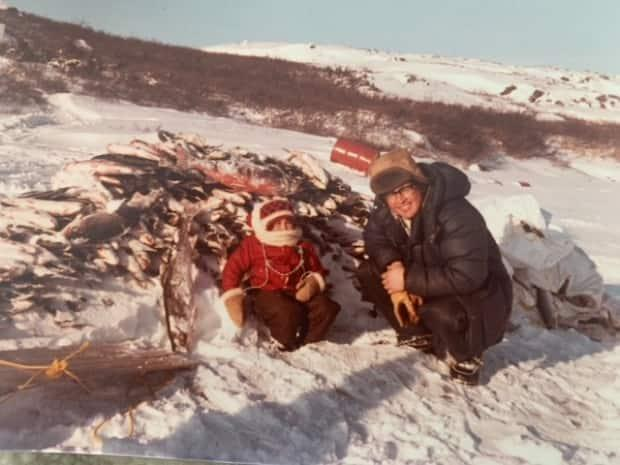 Johnny May and his daughter Jeannie May are pictured circa 1980. Jeannie says the Arctic char that Prince Philip received from her father possibly came from this fishing trip to Dulhut.