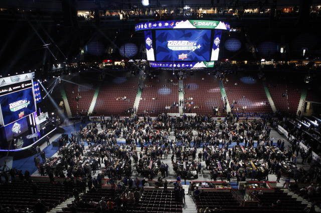 Teams, owners, coaches and other personnel get ready for the start of the second round of the NHL draft at Rogers Arena in Vancouver, British Columbia, Saturday, June 22, 2019. (Chad Hipolito/The Canadian Press via AP)