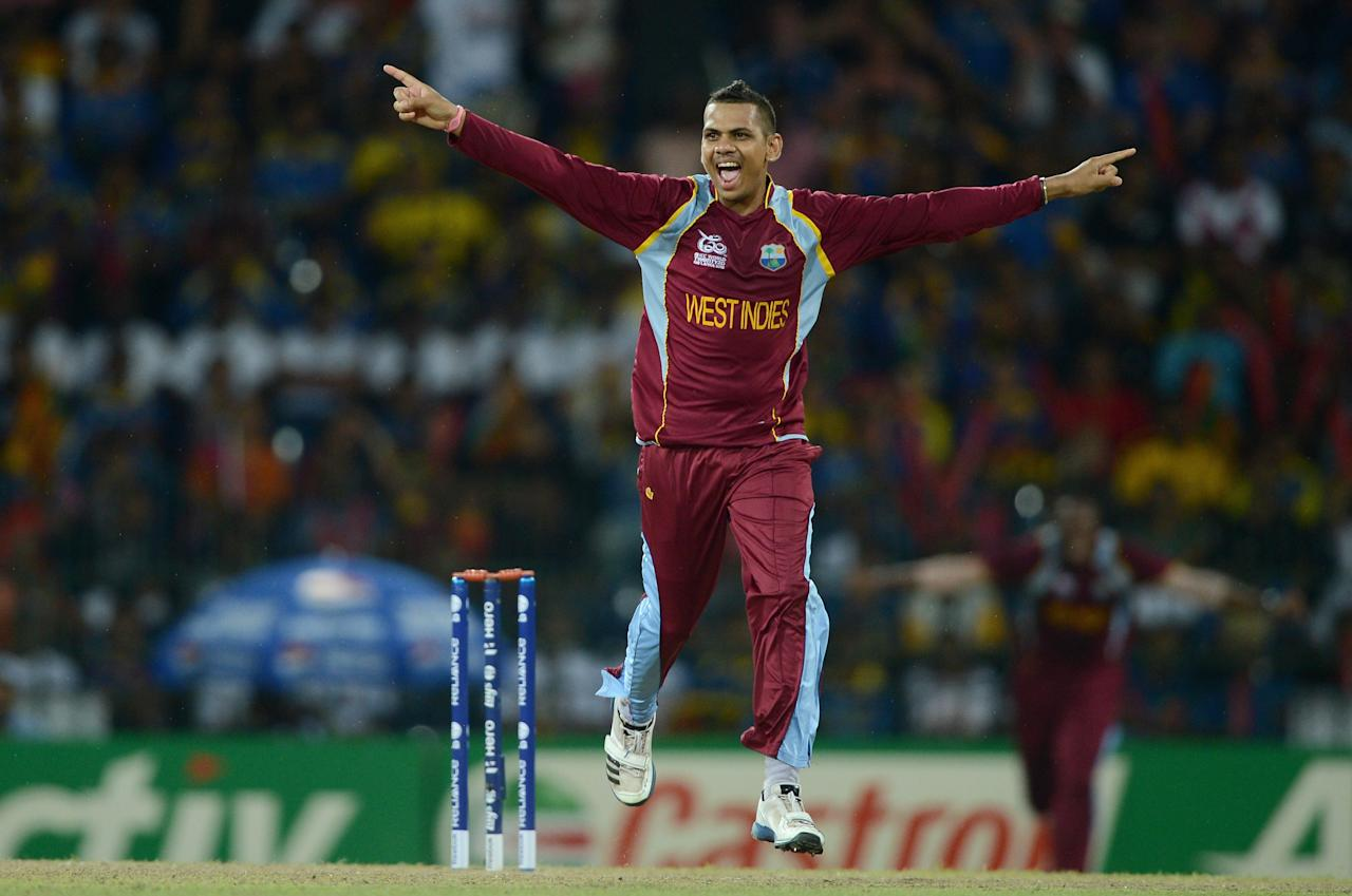 COLOMBO, SRI LANKA - OCTOBER 07:  Sunil Narine of the West Indies celebrates dismissing Sri Lanka captain Mahela Jayawardene during the ICC World Twenty20 2012 Final between Sri Lanka and the West Indies at R. Premadasa Stadium on October 7, 2012 in Colombo, Sri Lanka.  (Photo by Gareth Copley/Getty Images)