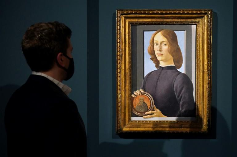 """Sold for $92 million -- Sandro Botticelli's """"Young Man Holding a Roundel"""" pictured at Sotheby's in New York City"""