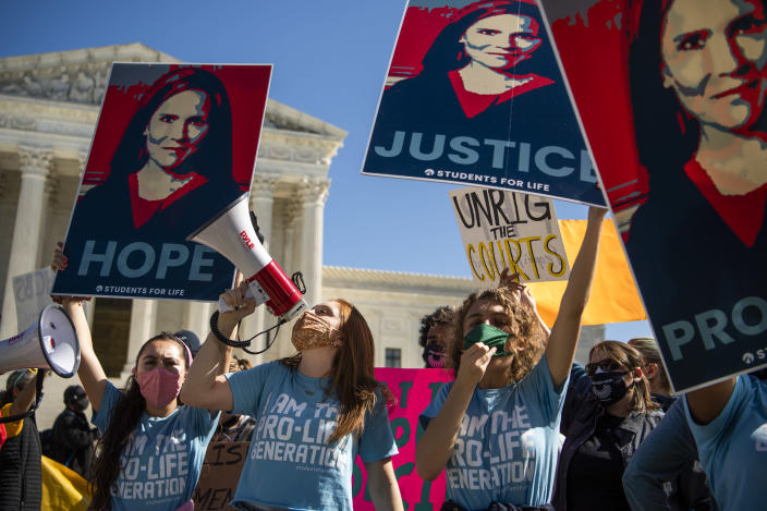 Demonstrators with Students for Life call for the confirmation of Supreme Court justice nominee Amy Coney Barrett during a protest at the Court on third day of the Senate Judiciary Committee confirmation hearing on Wednesday, October 14, 2020. (Tom Williams/CQ Roll Call via Getty Images)