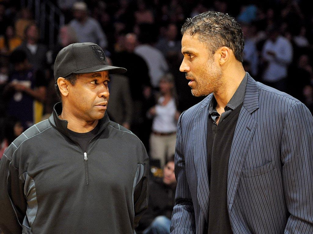 """Denzel Washington chatted up Rick Fox, who played for the Boston Celtics from 1991-97 and the LA Lakers from 1997-2004. We wonder who the former NBA star was rooting for since the teams share such an intense rivalry! IOS/London Ent/<a href=""""http://www.splashnewsonline.com/"""" target=""""new"""">Splash News</a> - February 18, 2010"""
