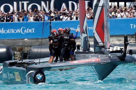 FILE PHOTO - Sailing - America's Cup finals - Hamilton, Bermuda - June 26, 2017 - Peter Burling, Emirates Team New Zealand Helmsman celebrates with his team after defeating Oracle Team USA in race nine to win the America's Cup. REUTERS/Mike Segar/File Photo