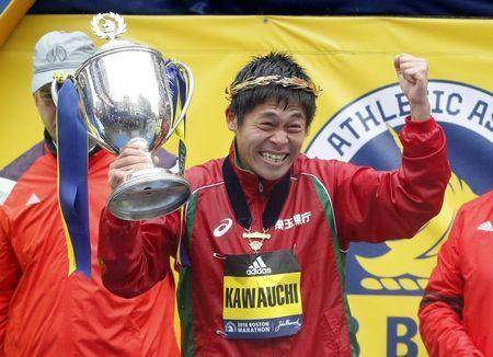 Apr 16, 2018; Boston, MA, USA; Yuki Kawauchi of Japan holds up the trophy after winning the 2018 Boston Marathon. Mandatory Credit: Winslow Townson-USA TODAY Sports