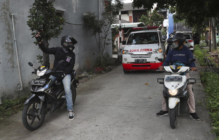 Motorcycle volunteers escort an ambulance carrying the body of a COVID-19 victim to a cemetery for burial in Bekasi on the outskirts of Jakarta, Indonesia, July 11, 2021. Indonesia surpassed the grim milestone of 100,000 official COVID-19 deaths on Wednesday, Aug. 4, 2021, as the country struggles with its worst pandemic year fueled by the delta variant, with growing concerns that the actual figure could be much higher with people also dying at home. (AP Photo/Achmad Ibrahim)