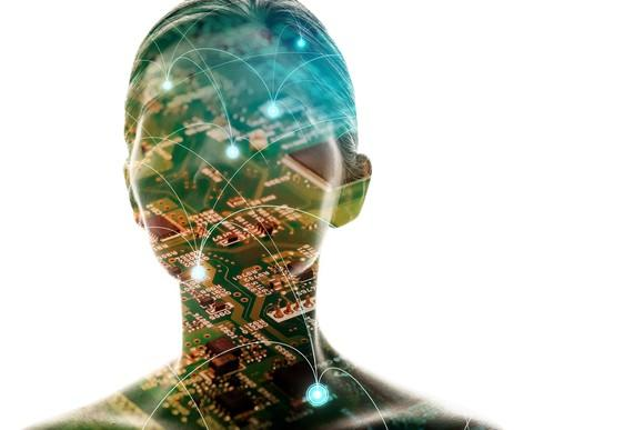 Silhouette of woman with computer motherboard projected on top of the image.