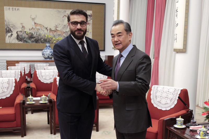 Afghanistan National Security Advisor Hamdullah Mohib, left, shakes hands with Chinese Foreign Minister Wang Yi before proceeding to their meeting at the Zhongnanhai Leadership Compound in Beijing, Thursday, Jan. 10, 2019. (AP Photo/Andy Wong, Pool)