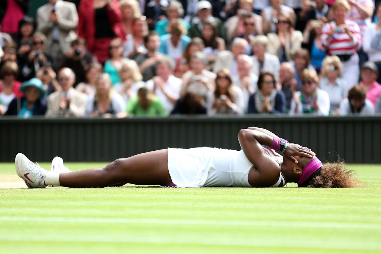 LONDON, ENGLAND - JULY 07:  Serena Williams of the USA celebrates match point during her Ladies? Singles final match against Agnieszka Radwanska of Poland on day twelve of the Wimbledon Lawn Tennis Championships at the All England Lawn Tennis and Croquet Club on July 7, 2012 in London, England.  (Photo by Julian Finney/Getty Images)