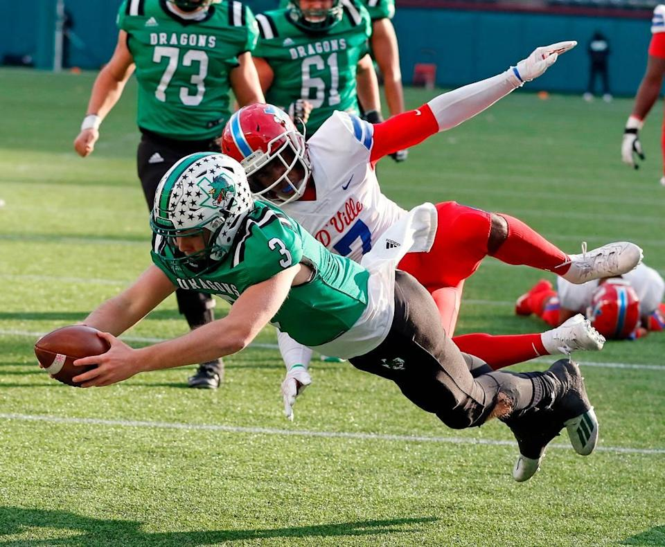 Southlake's Quinn Ewers dives into the end one for a touchdown during the Conference 6A Division 1 2020 state championship semi-final football game at Globe Life Park in Arlington, Texas, Saturday, Jan. 09, 2021. Duncanville led 27-21 at the half. (Special to the Star-Telegram Bob Booth)