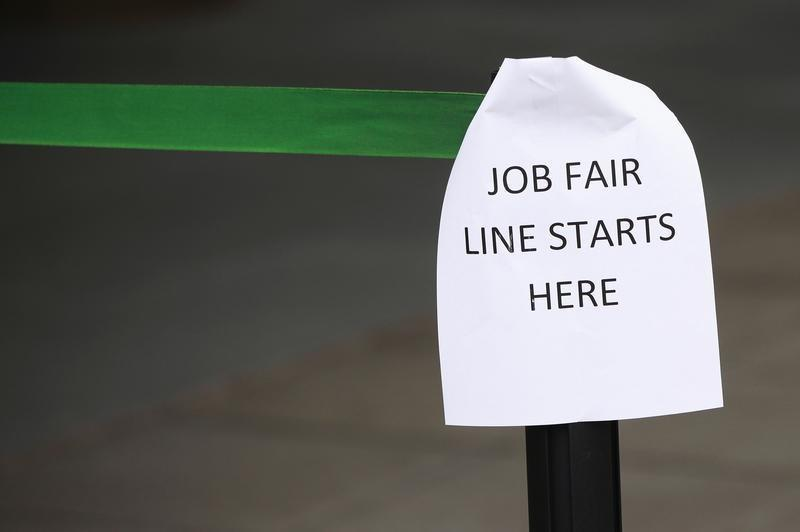 A sign marks the entrance to a job fair in New York