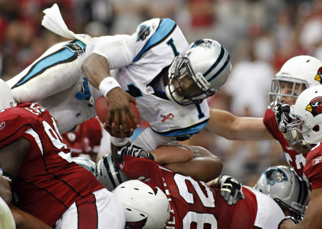 Cam Newton's rookie debut against Arizona in 2011 set NFL records. (Photo AP/Ralph Freso)