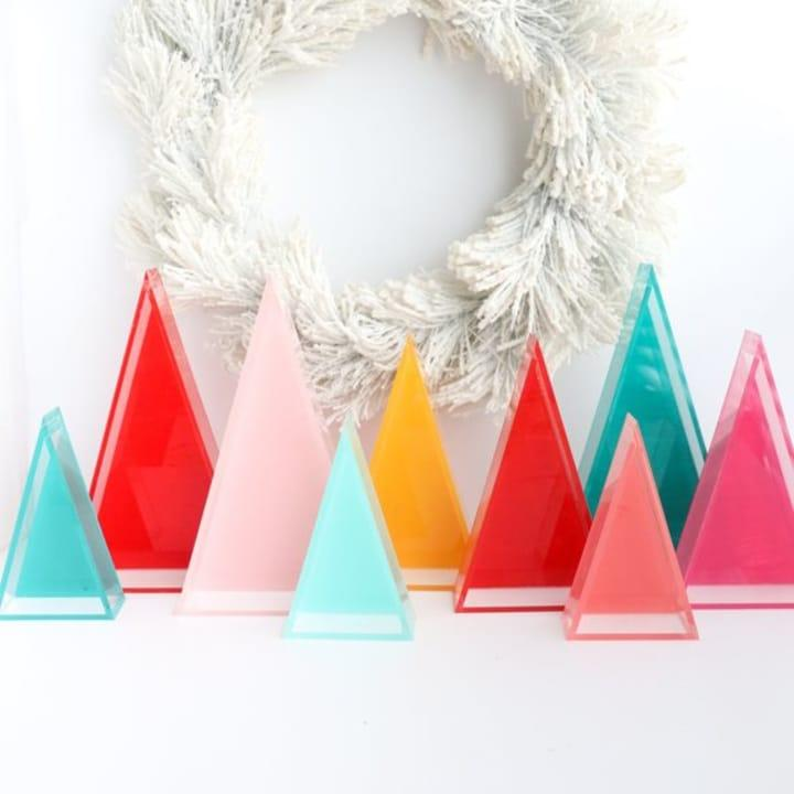 """If youre planning to venture outside the classic red-and-green holiday color scheme this year, we highly suggest building your palette around these infectiously cheerful Lucite Christmas trees.Colorful Lucite modern Christmas trees, $39.99 atkailochic/Etsy<br>See the full slideshow at <a rel=""""nofollow"""" href=""""http://www.sheknows.com/home-and-gardening/slideshow/10009/best-holiday-decor-of-2018/2"""">SheKnows</a>"""