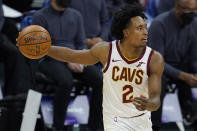 Cleveland Cavaliers guard Collin Sexton dribbles during the second half of the team's NBA basketball game against the Cleveland Cavalierss in Sacramento, Calif., Saturday, March 27, 2021. (AP Photo/Jeff Chiu)