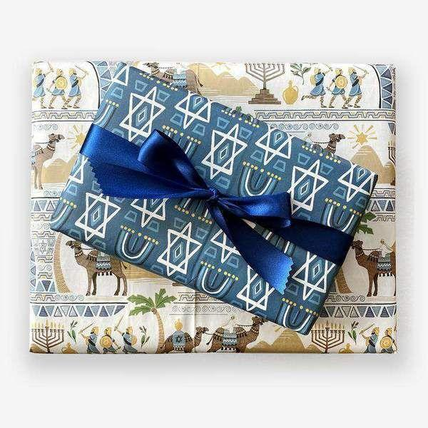 """<p>wrappily.com</p><p><strong>$10.00</strong></p><p><a href=""""https://wrappily.com/collections/christmas-holiday/products/hanukkah-story-by-paper-pony"""" rel=""""nofollow noopener"""" target=""""_blank"""" data-ylk=""""slk:Shop Now"""" class=""""link rapid-noclick-resp"""">Shop Now</a></p>"""