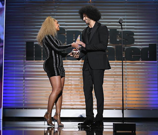 "<p>The ""Perfect"" singer made a surprise appearance at the Sports Illustrated 2017 Sportsperson of the Year Show on Tuesday night, at the Barclays Center in Brooklyn, where she presented Colin Kaepernick with the Muhammad Ali Legacy Award. Bey said she was ""proud and humbled"" to be there, and cheered the NFL player for taking action with ""no fear of consequence or repercussion. Only hope to change the world for the better."" (Photo: Slaven Vlasic/Getty Images for Sports Illustrated) </p>"