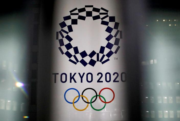 FILE PHOTO: The logo of Tokyo 2020 Olympic Games is seen through signboards, in Tokyo