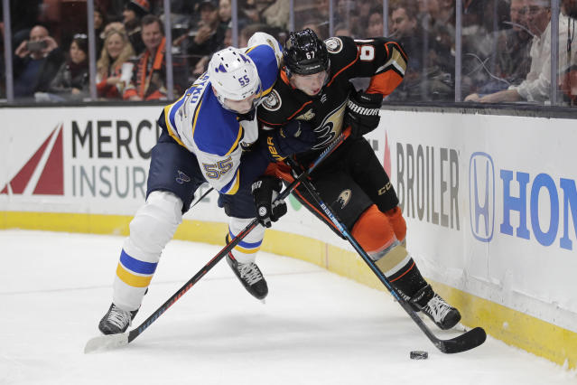 Anaheim Ducks' Rickard Rakell, right, of Sweden, is defended by St. Louis Blues' Colton Parayko during the second period of an NHL hockey game Wednesday, March 6, 2019, in Anaheim, Calif. (AP Photo/Jae C. Hong)