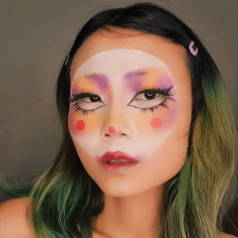 """<p>First, <strong>grab a <a href=""""https://go.redirectingat.com?id=74968X1596630&url=https%3A%2F%2Fwww.ulta.com%2Fwarrior-iii-eyeshadow-palette%3FproductId%3Dpimprod2004510&sref=https%3A%2F%2Fwww.cosmopolitan.com%2Fstyle-beauty%2Fbeauty%2Fg33247158%2Fcute-clown-halloween-makeup-tutorials%2F"""" rel=""""nofollow noopener"""" target=""""_blank"""" data-ylk=""""slk:pastel eyeshadow palette"""" class=""""link rapid-noclick-resp"""">pastel eyeshadow palette</a>, <a href=""""https://www.amazon.com/Mehron-Makeup-Paradise-Paint-White/dp/B00KIICOJE/?tag=syn-yahoo-20&ascsubtag=%5Bartid%7C10049.g.33247158%5Bsrc%7Cyahoo-us"""" rel=""""nofollow noopener"""" target=""""_blank"""" data-ylk=""""slk:white face paint"""" class=""""link rapid-noclick-resp"""">white face paint</a>, and<a href=""""https://www.cosmopolitan.com/style-beauty/beauty/a26887002/best-false-fake-eyelashes/"""" rel=""""nofollow noopener"""" target=""""_blank"""" data-ylk=""""slk:false lashes"""" class=""""link rapid-noclick-resp""""> false lashes</a></strong>. Then, paint the center of your face with the face paint to create your base. Once dry, use the shades from your palette and fluffy <a href=""""https://www.cosmopolitan.com/style-beauty/beauty/how-to/a40310/makeup-brushes-how-to/"""" rel=""""nofollow noopener"""" target=""""_blank"""" data-ylk=""""slk:makeup brushes"""" class=""""link rapid-noclick-resp"""">makeup brushes</a> to blend the colors on your brow bones and cheeks. Use <a href=""""https://www.cosmopolitan.com/style-beauty/beauty/g10229759/best-liquid-eyeliners/"""" rel=""""nofollow noopener"""" target=""""_blank"""" data-ylk=""""slk:liquid liner"""" class=""""link rapid-noclick-resp"""">liquid liner</a> to create a new dramatic eye shape and apply <a href=""""https://go.redirectingat.com?id=74968X1596630&url=https%3A%2F%2Fwww.ulta.com%2Fblack-magic-carnival-rio-eyelashes%3FproductId%3Dpimprod2014932&sref=https%3A%2F%2Fwww.cosmopolitan.com%2Fstyle-beauty%2Fbeauty%2Fg33247158%2Fcute-clown-halloween-makeup-tutorials%2F"""" rel=""""nofollow noopener"""" target=""""_blank"""" data-ylk=""""slk:falsies"""" class=""""link rapid-noclick-resp"""">falsies</a> for both your top and """