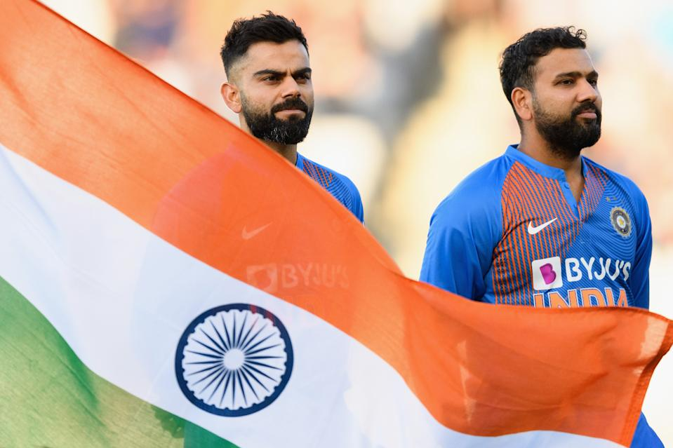 Captain Virat Kohli (pictured left) and vice-captain Rohit Sharma (pictured right) line up for their national anthem.