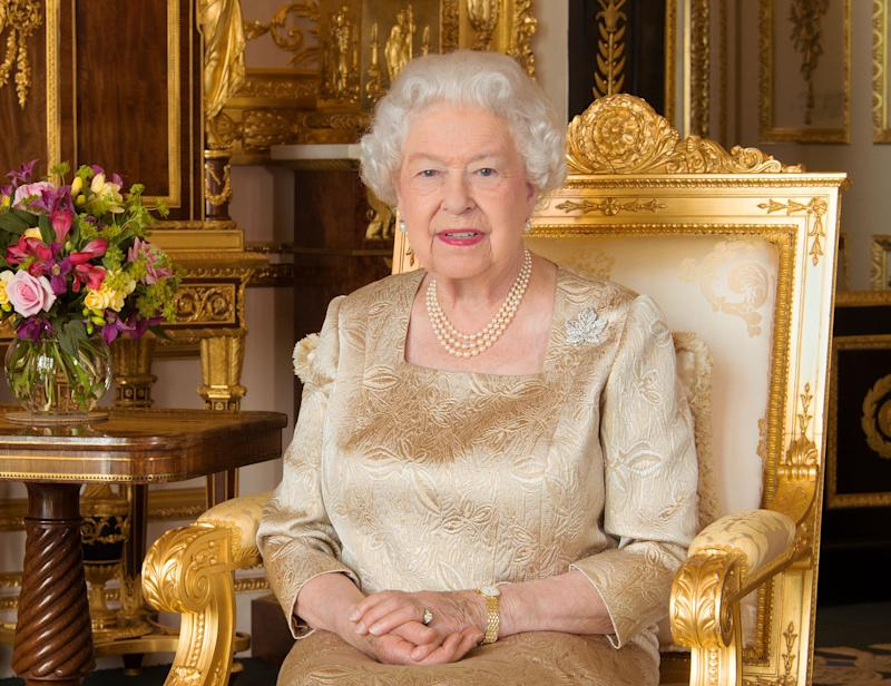 Queen Elizabeth II dressed in a gold color dress was captured on camera and she shows that old age has nothing on her