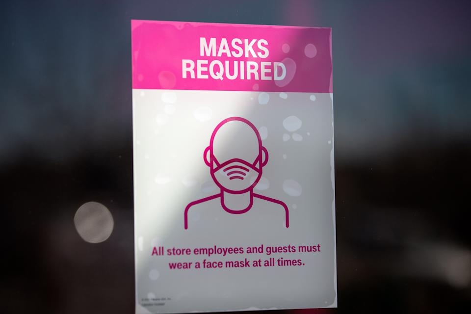 A sign about COVID-19 restrictions inside a T-Mobile store in Austin, Texas. Gov. Greg Abbott announced this week that the state will end its mask mandate and allow businesses to reopen at 100% capacity on March 10.  (Photo: Montinique Monroe via Getty Images)
