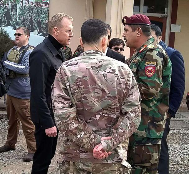 PHOTO: Acting Defense Secretary Patrick Shanahan, front left, speaks with Afghan general Besmellah Waziri, right, commander of the Afghan National Army Special Operations Command (ANASOC), at Camp Commando, near Kabul, Feb. 11, 2019. (Sylvie Lanteaume/AFP/Getty Images)