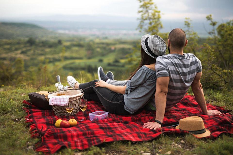"""<p>There's a reason picnicking is a summer date favorite. Lazing on a cozy blanket in a beautiful spot, drinking wine and feeding each other grapes...it's not only romantic, it's super-relaxing. And isn't kicking back what summer's all about?</p><p><strong>Related:</strong> <a href=""""https://www.countryliving.com/food-drinks/g783/picnic-recipes-0609/"""" rel=""""nofollow noopener"""" target=""""_blank"""" data-ylk=""""slk:Delightful Picnic Food Ideas to Make All Summer Long"""" class=""""link rapid-noclick-resp"""">Delightful Picnic Food Ideas to Make All Summer Long</a></p><p><a class=""""link rapid-noclick-resp"""" href=""""https://www.amazon.com/Picnic-Time-Country-Basket-Liner/dp/B01DZXINZM/ref=asc_df_B01DZXINZM/?tag=syn-yahoo-20&ascsubtag=%5Bartid%7C10050.g.35949770%5Bsrc%7Cyahoo-us"""" rel=""""nofollow noopener"""" target=""""_blank"""" data-ylk=""""slk:SHOP PICNIC BASKETS"""">SHOP PICNIC BASKETS</a></p>"""