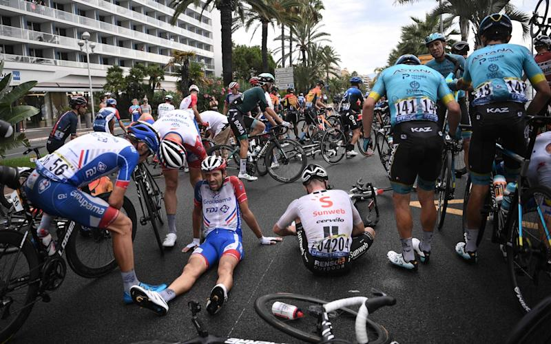 Thibaut Pinot (centre) was one of a number of riders to hit the deck on the opening day - AFP